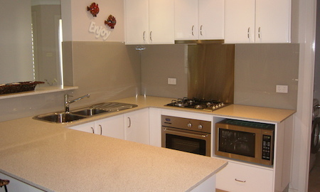 After Acrylic Splashback with an insert behind the gas cooktop