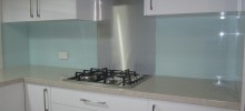 Acrylic Splashback  with Metaline insert behind gas cooktop