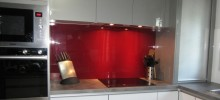 Red Acrylic Splashback with Induction Cooktop