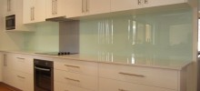 A Glass Green Acrylic Splashback with Metaline Insert in Brushed Aluminium