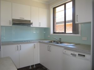 (This Shows A Glass Splashback Behind The Whole Cooktop Area And A Colour  Matching Acrylic Splashback Around The Sink.)