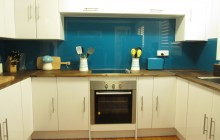 Metaline Splashback in Lagoon Metallic installed by OzzieSplash