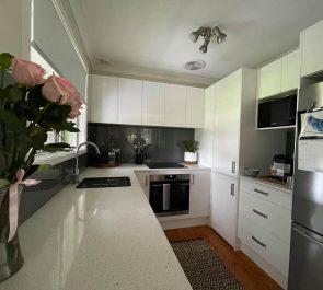 White Kitchen and Grey Glass Splashback