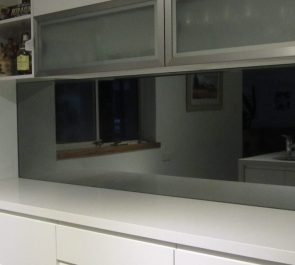 Silver grey mirror splashback